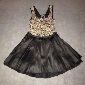 Trixxi junior's lace up black golden dress.Size S